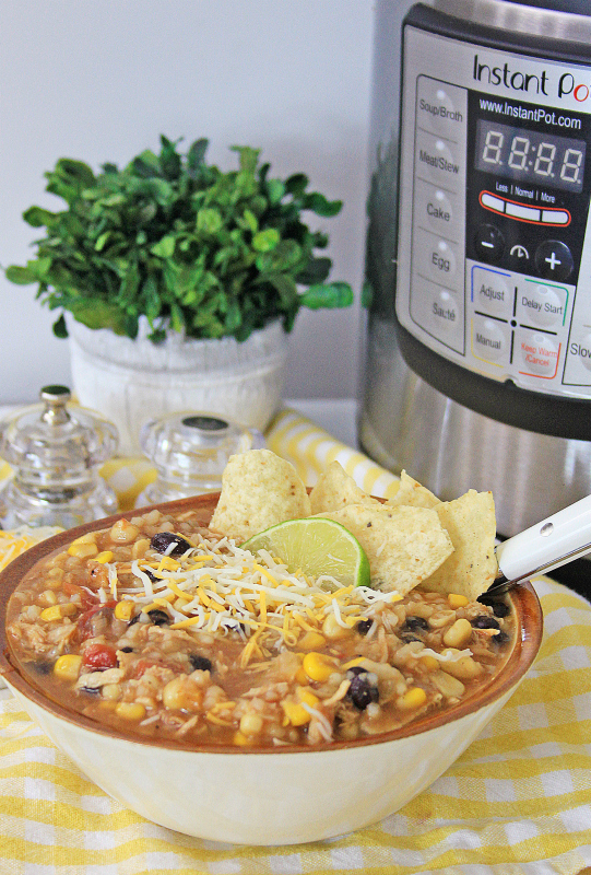 Instant Pot Mexican Chicken and Rice Soup served in a white bowl, with Instant Pot in the background