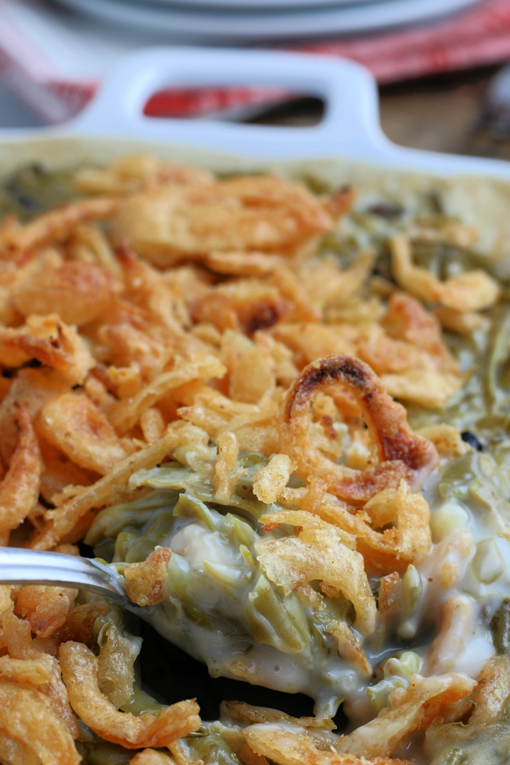 Easy Green Bean Casserole in a baking dish, with a spoon scooping out some