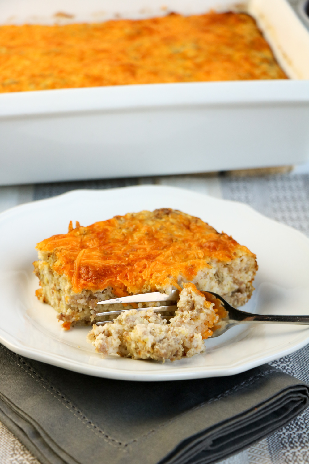 piece of casserole on a plate with a fork
