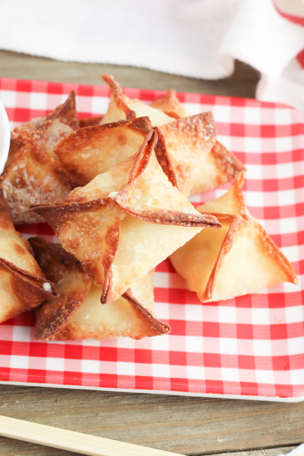 air fryer crab rangoon stacked on a plate